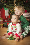 Mixed Race Baby and Young Boy Enjoying Christmas Morning Near Th Stock Images