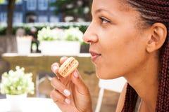 Girl eating macaron royalty free stock image