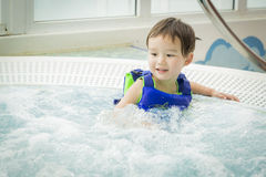 Mixed Race Boy Having Fun at the Water Park Royalty Free Stock Photography