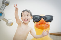 Mixed Race Boy Having Fun at the Water Park Stock Photo