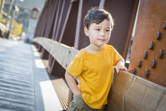 Mixed Race Boy Leaning on Bridge Outdoors Royalty Free Stock Image