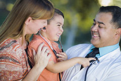 Mixed Race Boy, Mother and Doctor Having Fun With Stethoscope Stock Image