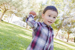 Mixed Race Boy Playing Football Outside Royalty Free Stock Images