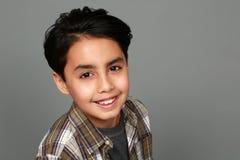 Mixed race boy smiling stock photo