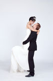 Mixed Race Bride and Groom in Studio Stock Photography