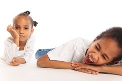 Mixed-race Children Playing On The Floor. Mixed-race brother and sister playing on the floor Stock Image