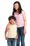 Mixed Race Brother and Sister. Two young mixed race children, brother and sister. Isolated on studio white background royalty free stock images