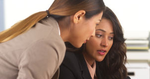 Mixed race business colleagues having a discussion Stock Photos