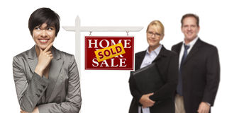 Mixed Race Business People with Sold Real Estate Sign Isolated Stock Photos