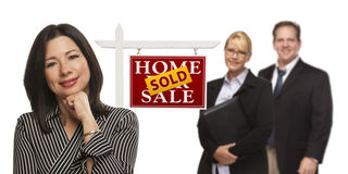 Mixed Race Business People with Sold Real Estate Sign Isolated Stock Images