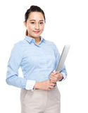 Mixed race business woman with notebook computer Stock Photo