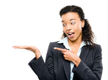 Mixed race businesswoman showing empty copyspace isolated on whi Stock Photography