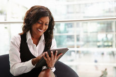 Mixed race businesswoman using digital tablet, waist up Royalty Free Stock Image