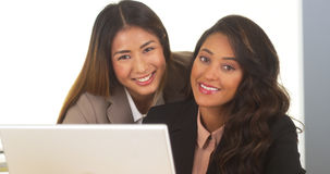 Mixed race businesswomen smiling at camera Royalty Free Stock Image