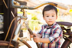 Mixed Race Caucasian and Chinese Young Boy Having Fun on the Bic Royalty Free Stock Photo