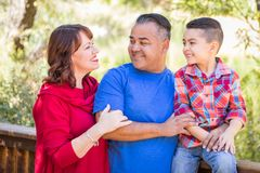 Mixed Race Caucasian and Hispanic Family Outdoors. Mixed Race Caucasian and Hispanic Family At The Park stock photos