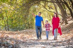 Mixed Race Caucasian and Hispanic Family Taking a Walk At The Pa Stock Image