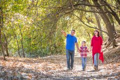Mixed Race Caucasian and Hispanic Family Taking a Walk Outside. Mixed Race Caucasian and Hispanic Family Taking a Walk At The Park stock images