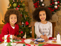 Mixed race children making Christmas cards Royalty Free Stock Image