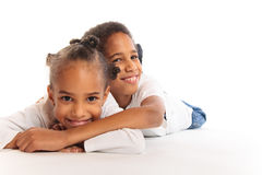 Mixed-race Children Playing On The Floor. Mixed-race brother and sister playing on the floor Royalty Free Stock Photography