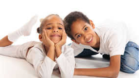 Mixed-race Children Playing On The Floor. Mixed-race brother and sister playing on the floor Stock Photo