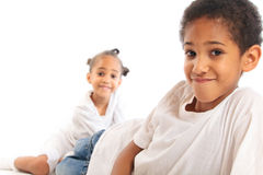 Mixed-race Children Playing On The Floor. Mixed-race brother and sister playing on the floor Royalty Free Stock Photos