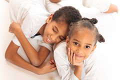 Mixed-race Children Playing On The Floor. Mixed-race brother and sister playing on the floor Stock Images