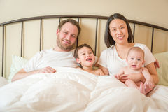 Mixed Race Chinese and Caucasian Baby Boys Laying In Bed with Th Royalty Free Stock Image