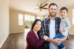 Mixed Race Chinese and Caucasian Parents and Child Inside Empty Royalty Free Stock Photography