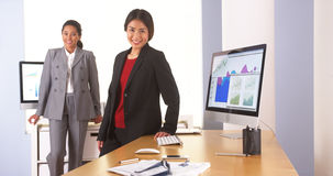 Mixed race colleagues working Stock Image