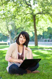 Mixed race college student with laptop Royalty Free Stock Image