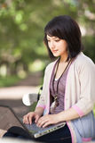 Mixed race college student with laptop Stock Image