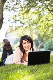 Mixed race college student with laptop Stock Photos