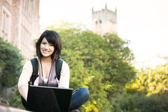 Mixed race college student with laptop Stock Images