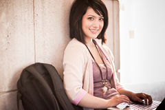 Mixed race college student with laptop Stock Photography