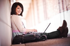 Mixed race college student with laptop Royalty Free Stock Images