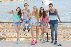 Mixed race confident teens on student vacation Stock Photo