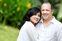 Mixed race couple. Portrait of a happy mixed race couple in the park Royalty Free Stock Photo
