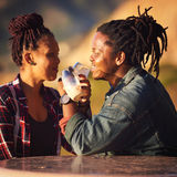 Mixed race couple of African descent making an intertwined toast Royalty Free Stock Photos
