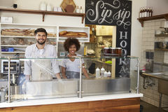 Mixed race couple behind the counter at a sandwich bar royalty free stock photo
