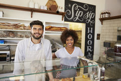 Mixed race couple behind counter at sandwich bar, close up royalty free stock images