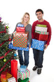 Mixed race couple carrying Christmas presents Stock Image