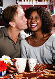 Mixed race couple in coffee house Stock Images
