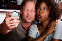 Mixed race couple in coffee house with taking pict Stock Image