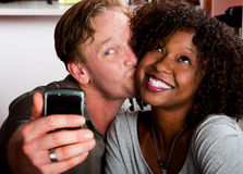 Mixed race couple in coffee house with taking pict Stock Photos