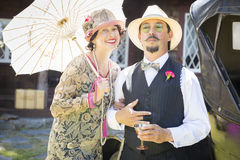 Mixed-Race Couple Dressed in 1920's Era Fashion Sipping Champa Stock Image
