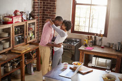 Mixed race couple embracing in kitchen, elevated view Royalty Free Stock Photos