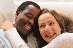 Mixed race couple enjoying each other royalty free stock photo