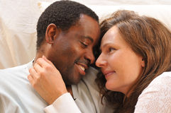 Mixed race couple enjoying each other Stock Photography