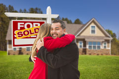 Mixed Race Couple, House, Sold Real Estate Sign Stock Photo